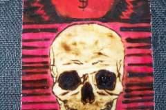 Baltrukonis-red-skull-wood-burn